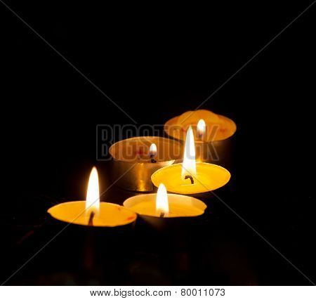 Five small burning candles