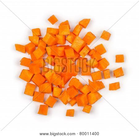 Cut Into Squares Pieces Of Carrot On A White Background