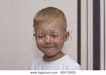 boy smiling portrait with closed eyes