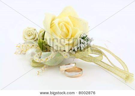 Wedding Rings With A Small Bouquet