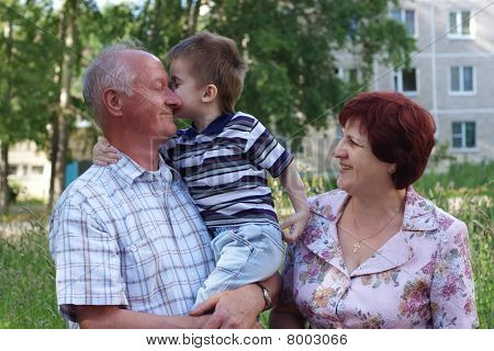 grandmother and grand-dad with a grandchild