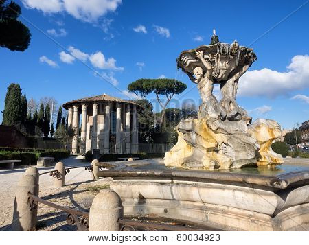 Temple Of Hercules Victor In The Forum Boarium In Rome With The Triton Fountain In Front