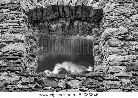 Empty Window Hole Giving View To Dark Sky, Bw
