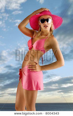 Girl In Pink Bikini With Hat