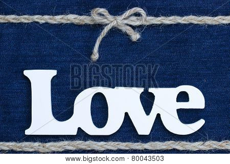 Love text with rope border on denim background