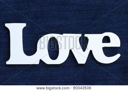 Wood Love text on blue denim background