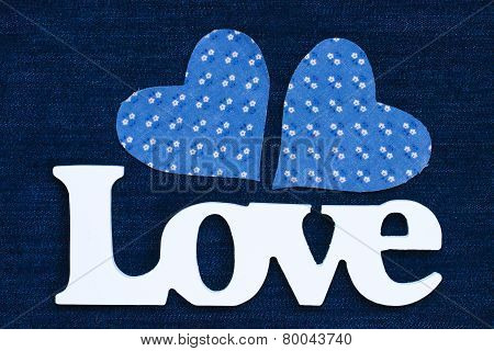 Wood Love text with blue hearts on denim jeans background
