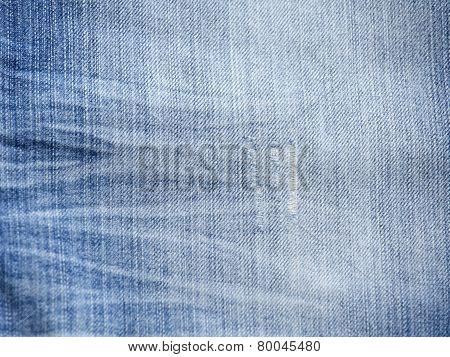 Texture of threadbare denim of indigo color