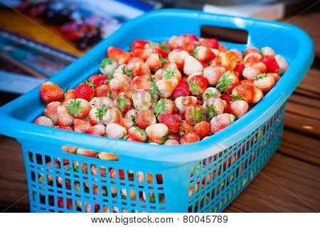 Strawberries In A Basket On The Garden Farm