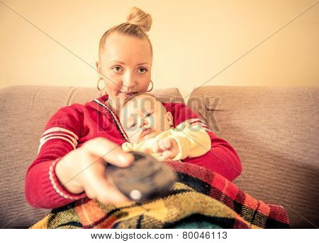 Mom And Her Baby Watching Tv