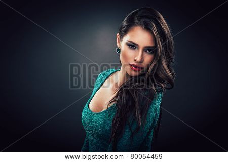 Beautiful Young Woman In A Green Dress With Long Dark Hair
