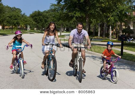 poster of A modern family of two parents and two children a boy and a girl cycling together.