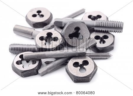 Thread cutting taps and dies isolated on white