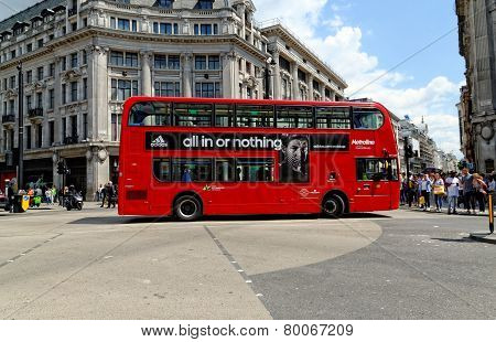 A London red bus bearing Adidas advertisement