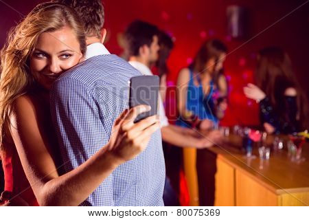 Cute couple slow dancing together at the nightclub