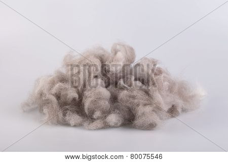Raw wool yarn coiled into a ball