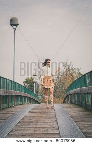 Beautiful Young Woman Posing On A Bridge