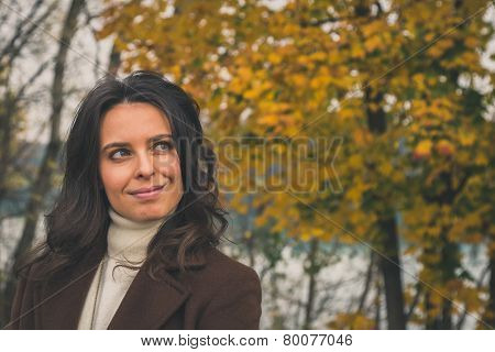 Beautiful Young Woman Posing In A City Park