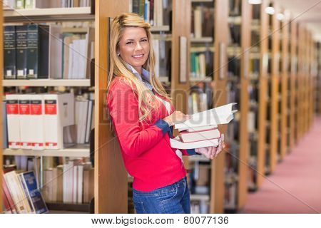 Mature student standing in library at the university