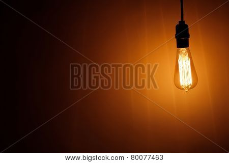 vintage bulb lamp with warm light, copy-space background