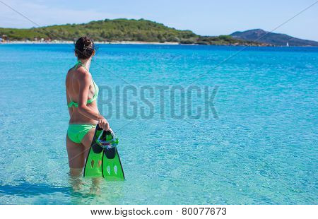Young beautiful woman with snorkel in clear sea