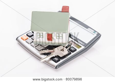Keys With House And Calculator.