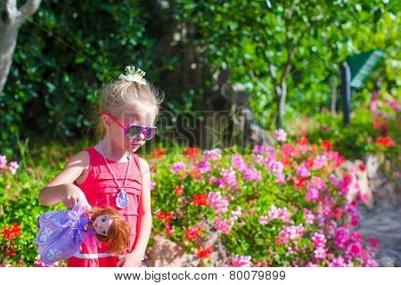 Adorable little girl at tropical vacation