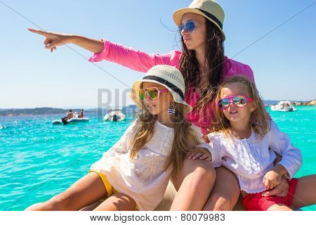 Little girls resting with happy mom on a big boat