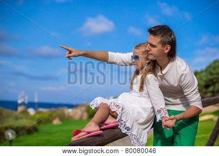 Adorable little girl and happy dad outdoor