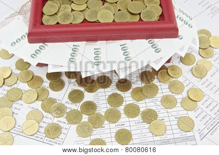 Gold Coins On Red Treasure Box And Bills