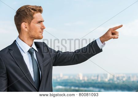 Businessman Pointing Away.