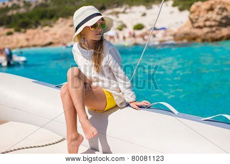 Little girl enjoying sailing on boat in the open sea