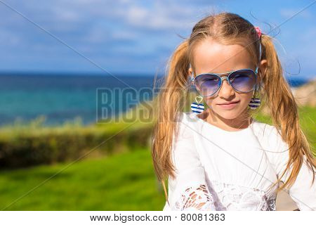 Adorable little girl outdoors during summer vacation
