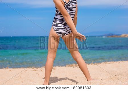 Adorable little girl have fun during tropical beach