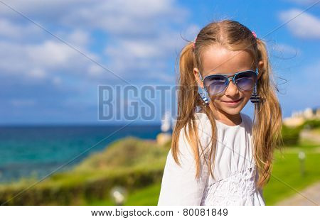 Adorable little girl during summer vacation outdoors