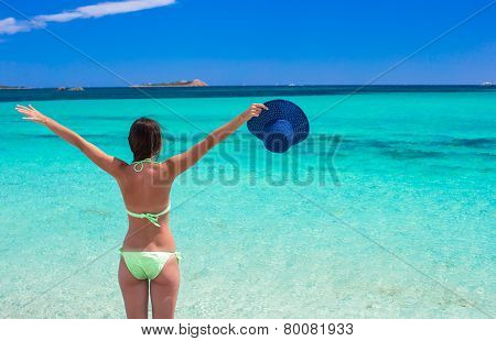 Young beautiful girl relaxing at white sand tropical beach