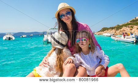 Little girls resting with happy mother on a big boat