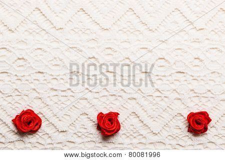 Frame Of Red Silk Roses On Lace