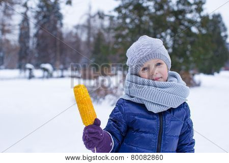 Portrait of little cute girl at winter park