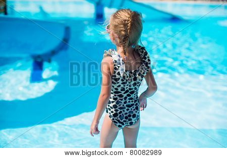 Little girl at aquapark during summer holiday