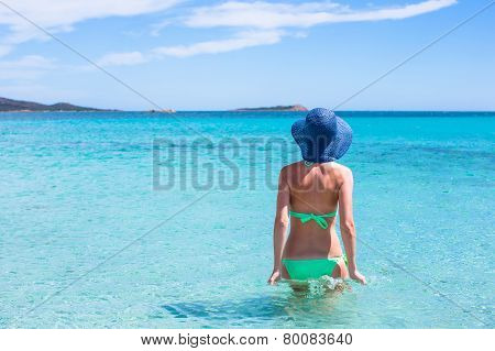 Young woman relaxing at tropical beach during summer vacation