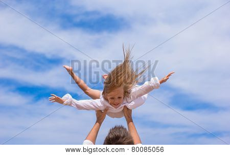 Adorable little girl and happy father have fun