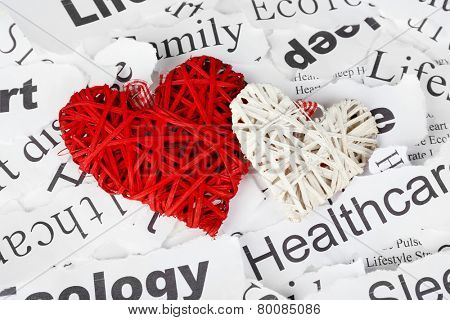Decorative wicker hearts on background of paper notes