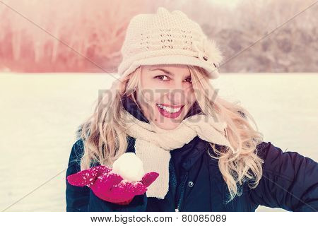 Woman In Snow Holding Snow Ball On Hand For Snowballing