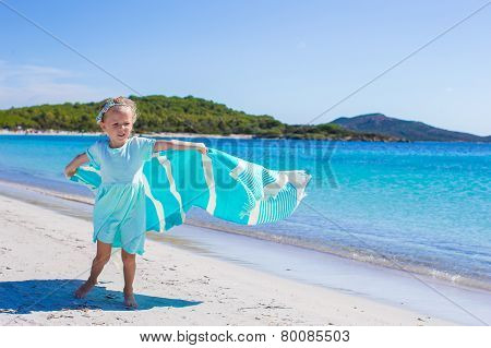 Little girl during tropical vacation have fun on white beach