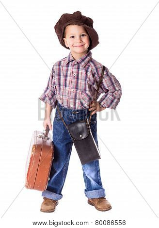 Little boy with old suitcase