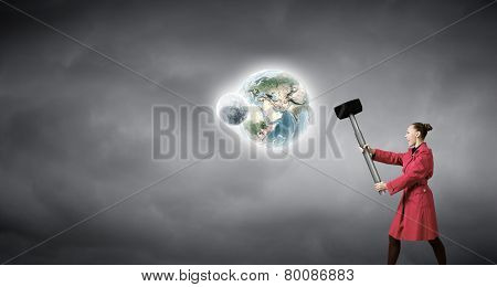 Rear view of woman in red coat with hammer in hands. Elements of this image are furnished by NASA
