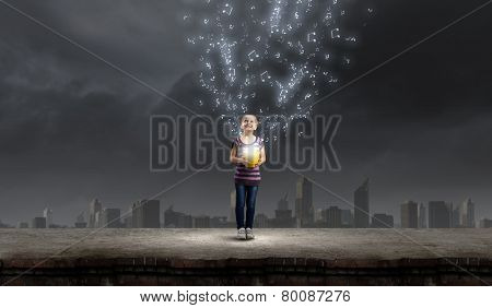 Little cute girl catching pouring characters with bucket