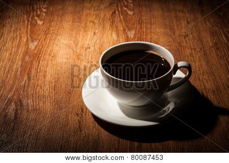 Still-life With A Cup Of Black Coffee And Roasted Coffee Beans