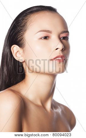 Closeup studio portrait of a beautiful young woman with perfect glowing skin